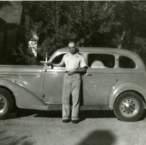 Image of Chester J. Petrie with his 1936 Plymouth