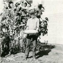 Image of John Hampton standing in garden