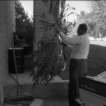 Image of Deputy Stanley Smith and marijuana evidence