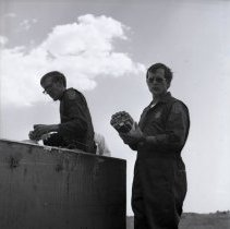 Image of Bomb Technicians Robert Hawkins and Robert Pearson.