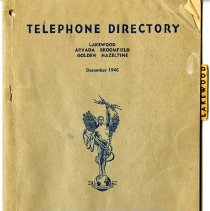 Image of Telephone directory dated December 1946 for the cities Lakewood, Arvada, Broomfield, Golden, and Hazeltine.  The directory was published by The Mountain States Telephone and Telegraph Company.  Directory includes business advertisements for the above cities.