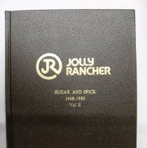 "Image of Bound volume of Jolly Rancher Candy newsletters titled, ""Sugar and Spice"" 1968-1983 Vol. II. Monthly newsletters created for employees and customers, edited by Dorothy B. Harmsen."