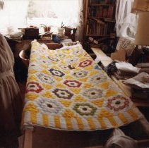 "Image of Eugenia Mitchell with ""Flower Garden with Fence"" quilt"