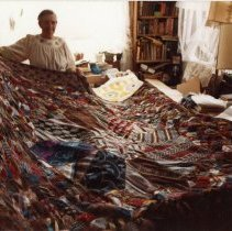 Image of Eugenia Mitchell with large quilt