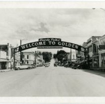 "Image of 1940s postcard with ""Welcome"" arch"