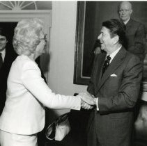 Image of Holland Coors with President Reagan at The White House