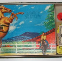 Image of Annie Oakley game pieces