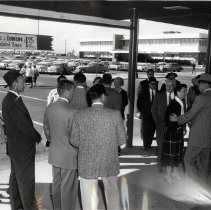 Image of Carl Enlow and crowd at Stapleton Airport, 1957