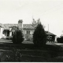 Image of Schneider House at Wide Acres with car and girl