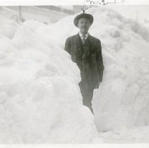 Image of John Linder standing next to snowbank, Blizzard of 1913