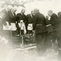 Image of Buffalo Bill funeral - lowering the casket