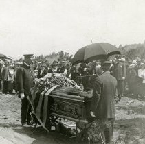 Image of Buffalo Bill funeral - coffin with crowd in background
