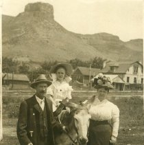 Image of Child on donkey, Castle Rock in background