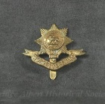 Image of 1932.0076.01 - Badge, Cap