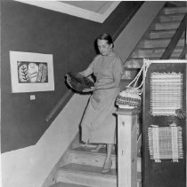 Image of Woman Descending Stairs at CAA - Unknown