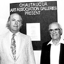 Image of Art Faculty in Front of Bulletin Board - Unknown