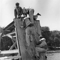 Image of Men Climbing Rope Ladder - Unknown