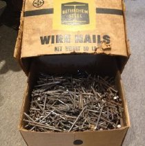 Image of inside box full of nails