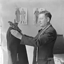 Image of Mr. Glassner tailoring a coat