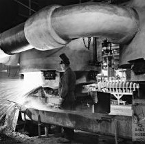 Image of Workers smelting metal