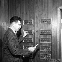 Image of Worker adjusting heating ctrls