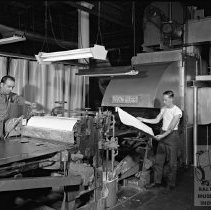 Image of Workers at machinery