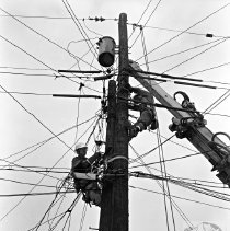 Image of Workers on top of a pole