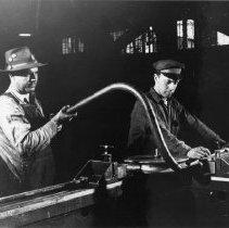 Image of Men bending pipe