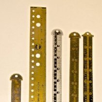 Image of #23  Printer's Type Rulers- 1 Aluminum, 4 Brass  (3- H.b. Rouse, 1-turtle's