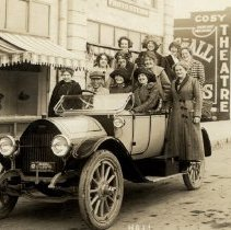 Image of A car-load of girls outside Cosy Theater