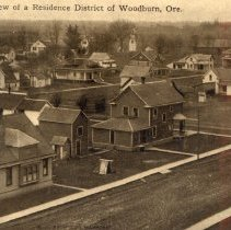 Image of Residential section with sidewalks, but streets unpaved