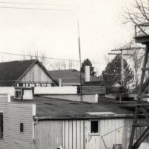 Image of Corner of Arthur and First Streets.  Back of Woodburn Creamery with water tower behind. - 2015FIC956