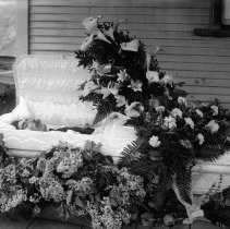 Image of Funeral 9 Man in his casket outside home. Hall-FU-9 - 2015FIC1656