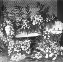 Image of Funeral 16a Casket and flowers Hall-FU-16a - 2015FIC1661