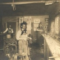 Image of Harness shop George Becker in fron, Captain Henderson on right - 2016FIC2054