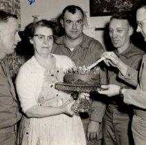 Image of Marines Richard Caldwel, E.G.Bukowski, Jack McFarlane, R.E.Sohn, and Mrs. Sam Carter - 2016FIC2772