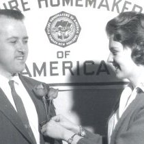 Image of Mayor Del Garner gets a rose from Mary Fiken of Future Homemakers - 2016FIC2807