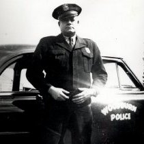 Image of Policeman Les Church with his Police Car - 2016FIC3288