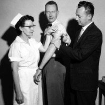 Image of Salk Polio Vacine Clinic.  Mrs. Oscar Blanchard, Wally Gutzler, and Dr. Paul Asper - 2016FIC3851