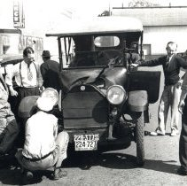 Image of Looking over vintage 1926 auto in 1939 - 2016FIC4231