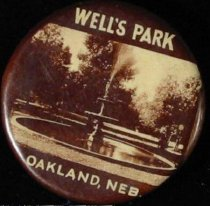 Image of 11571-55 - Button, Booster, Wells Park Oakland, Neb.; Sepia Photo Fountain, Trees