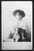 Image of Young Girl and Puppies