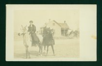 Image of Two Horseriders in Front of a House