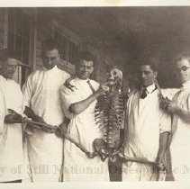 Image of 2008.59 - Roy V. Gerken and four others in lab coats with Skelton