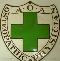 Image of 2008.59 - A. O. A. Osteopathic Physician green cross Shield for car