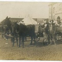 Image of Couple standing in front of wagon