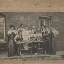 Image of Photograph of Dr. A. T. Still instructing students during dissection, outsi