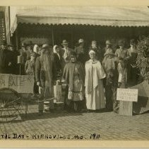 Image of 1974.34 - Men and women in costumes in front of Kirksville downtown business during American School of Osteopathy Hospital Day