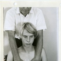 Image of 2011.36 - Photograph of Magoun Giving OMM Treatment to Young Boy