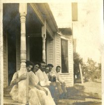 Image of 2010.87 - Photograph of Group Sitting Off a Porch